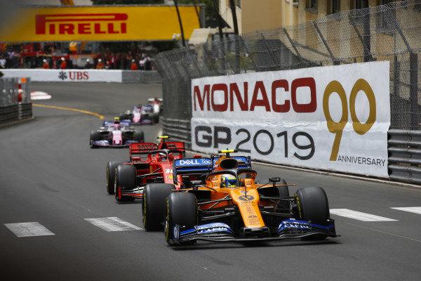 Lando Norris, McLaren MCL34, leads Charles Leclerc, Ferrari SF90, and Lance Stroll, Racing Point RP19