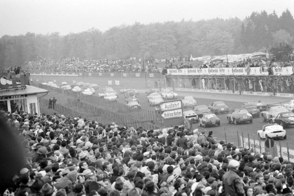 Spectators watch the field at the start.