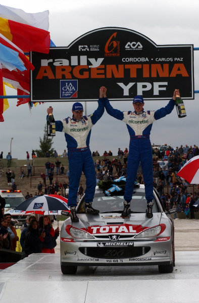 World Rally Championship, Rally of Argentina, May 16-19, 2002.Richard Burns and Robert Reid celebrate their unexpected victory.Photo: Ralph Hardwick/LAT