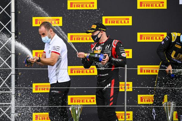 Nikita Mazepin (RUS, HITECH GRAND PRIX), 1st position, sprays the victory Champagne on the podium