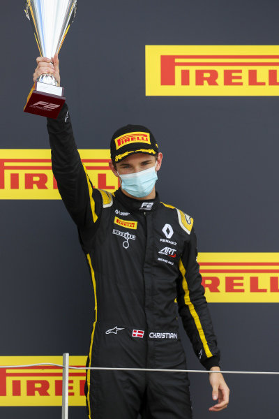 Christian Lundgaard (DNK, ART GRAND PRIX) celebrates on the podium with the trophy