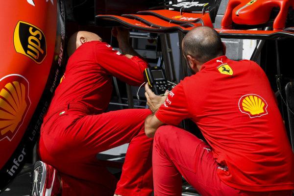 Ferrari mechanics with the front wing of Ferrari SF90