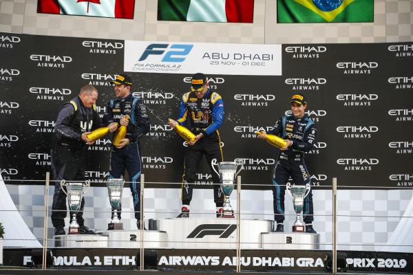 Luca Ghiotto (ITA, UNI VIRTUOSI), celebrates victory on the podium with Nicholas Latifi (CAN, DAMS) and Sergio Sette Camara (BRA, DAMS)