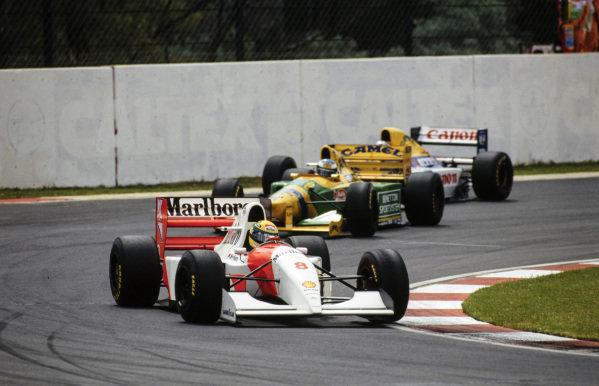Ayrton Senna, McLaren MP4-8 Ford, leads Michael Schumacher, Benetton B193A Ford, and Alain Prost, Williams FW15C Renault.