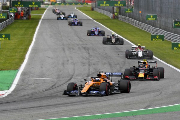 Carlos Sainz Jr., McLaren MCL34, leads Alexander Albon, Red Bull RB15, Antonio Giovinazzi, Alfa Romeo Racing C38, and Kevin Magnussen, Haas VF-19