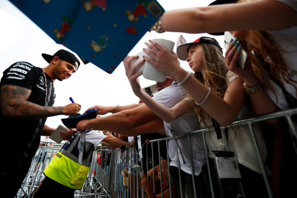 Hungaroring, Budapest, Hungary. Thursday 23 July 2015. Lewis Hamilton, Mercedes AMG, signs autographs for fans. World Copyright: Charles Coates/LAT Photographic ref: Digital Image _N7T1835