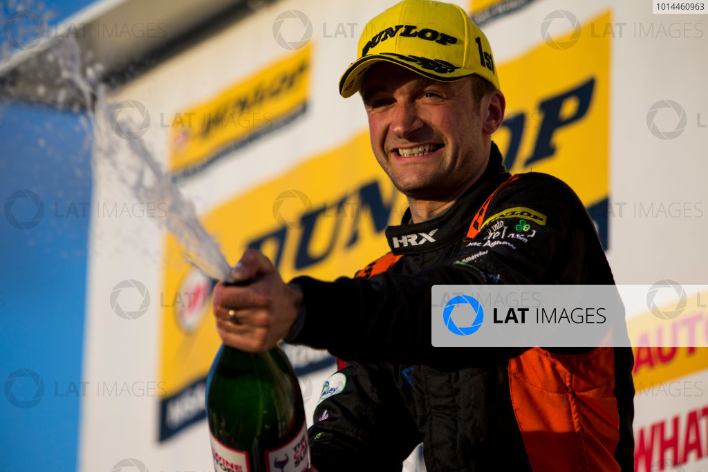 2015 British Touring Car Championship, Silverstone, Northamptonshire, England. 26th - 27th September 2015. Colin Turkington (GBR) Team BMR Volkswagen Passat CC, 1st position, on the podium. World Copyright: Zak Mauger/LAT Photographic. ref: Digital Image _L0U4875