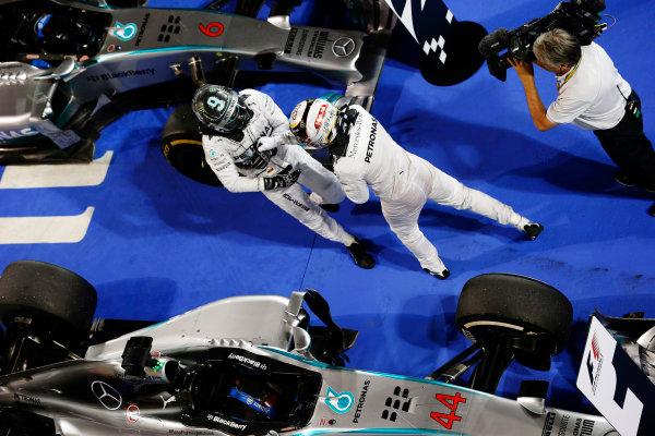 Bahrain International Circuit, Sakhir, Bahrain. Sunday 6 April 2014. Lewis Hamilton, Mercedes AMG, 1st Position, and Nico Rosberg, Mercedes AMG, 2nd Position, celebrate in Parc Ferme. World Copyright: Steven Tee/LAT Photographic. ref: Digital Image _L4R7903
