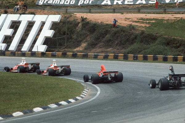 Interlagos, Sao Paulo, Brazil. 23-25 January 1976. Clay Regazzoni, leads Niki Lauda, both Ferrari 312T, James Hunt, McLaren M23 Ford, and Jean-Pierre Jarier, Shadow DN5B Ford. Ref: 76BRA10. World Copyright - LAT Photographic
