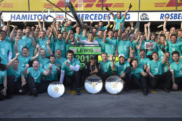 Albert Park, Melbourne, Australia. Sunday 15 March 2015. Lewis Hamilton, Mercedes AMG and Nico Rosberg, Mercedes AMG celebrate with their team after winning the race. World Copyright: Steve Etherington/LAT Photographic. ref: Digital Image SNE21601