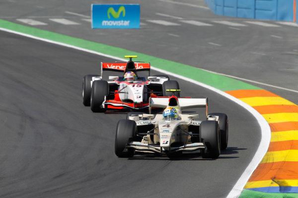 Valencia Spain. 27th June. Sunday Race. Sergio Perez (MEX, Barwa Addax Team) and Luiz Razia (BRA, Rapax). Action. Portrait. Photo: Andrew Ferraro/GP2 Media Service. Ref: _O9T4576 jpg