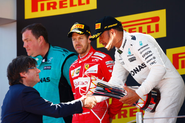 Circuit de Catalunya, Barcelona, Spain. Sunday 14 May 2017. Lewis Hamilton, Mercedes AMG, 1st Position, receives his trophy alongside Sebastian Vettel, Ferrari, 2nd Position. World Copyright: Andy Hone/LAT Images ref: Digital Image _ONZ6680