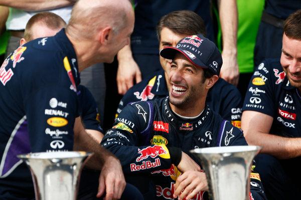Hungaroring, Budapest, Hungary. Sunday 27 July 2014. Daniel Ricciardo, Red Bull Racing, 1st Position, celebrates with his team. World Copyright: Sam Bloxham/LAT Photographic. ref: Digital Image _SBL1284