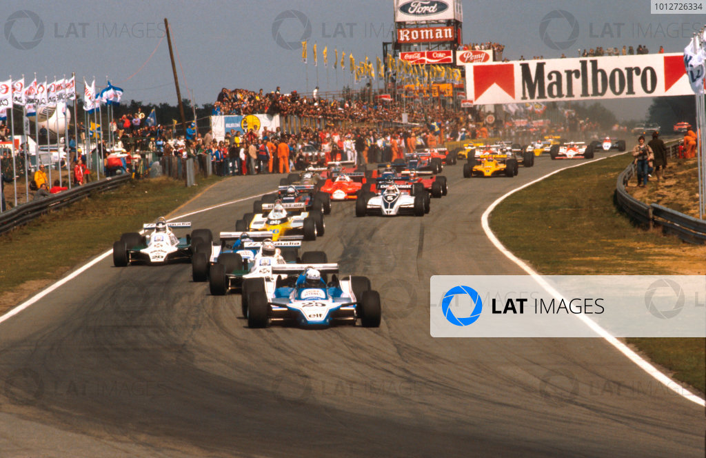 1980 Belgian Grand Prix.Zolder, Belgium.2-4 May 1980.Didier Pironi (Ligier JS11/15 Ford) leads Alan Jones (Williams FW07B Ford), Jacques Laffite (Ligier JS11/15 Ford), Carlos Reutemann (Williams FW07B Ford) and Rene Arnoux (Renault RE20) into the first turn at the start.Ref-80 BEL 06.World Copyright - LAT Photographic
