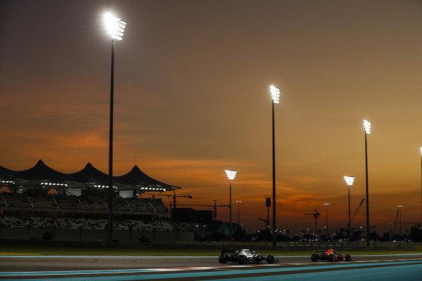 Alexander Albon, Red Bull RB15, leads Lewis Hamilton, Mercedes AMG F1 W10
