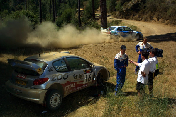 2001 Cyprus Rally.Harri Rovanpera is interviewed by the press besides his broken car.Photo:McKlein.