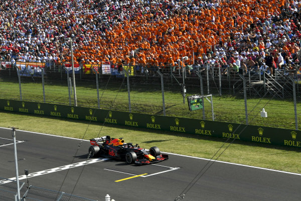 Max Verstappen, Red Bull Racing RB15 passes fans