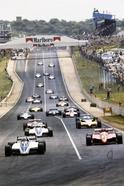 Nelson Piquet, Brabham BT50 BMW, leading Gilles Villeneuve, Ferrari 126C2, Riccardo Patrese, Brabham BT50 BMW, and Alain Prost, Renault RE30B, at the start.
