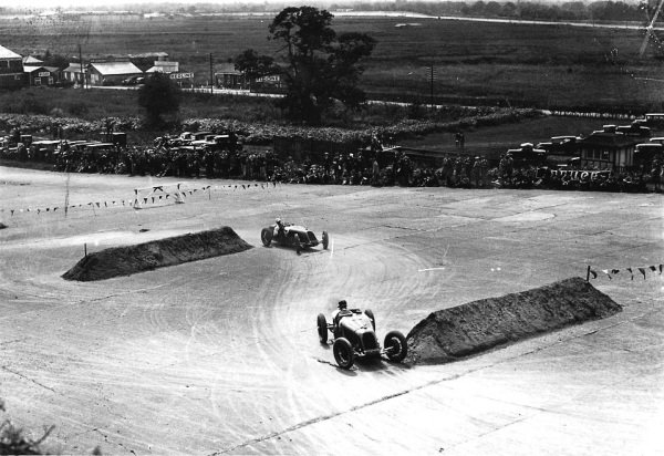 Brooklands, Great Britain.7 August 1926.Albert Divo leads Henry Segrave (both Talbot 700). World Copyright: LAT Photographic. Ref: Autocar Glass Plate A6509.