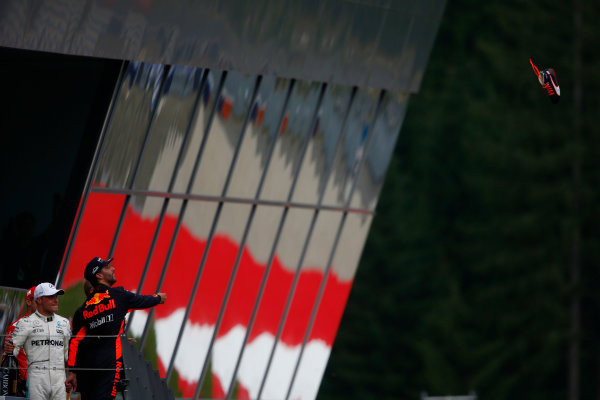 Red Bull Ring, Spielberg, Austria. Sunday 9 July 2017. Daniel Ricciardo, Red Bull Racing, 3rd Position, throws his shoe from the podium. Photo: Andrew Hone/McLaren ref: Digital Image _ONY3673