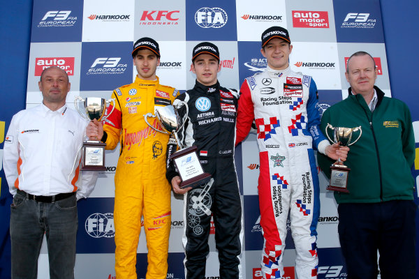 FIA F3 European Championship - Round 1, Race 3. Silverstone, Northamptonshire, UK 10th - 12th April 2015 Prize giving ceremony, Christophe Stucki (Hankook Senior Manager Motorsport), 3 Antonio Giovinazzi (ITA, Jagonya Ayam with Carlin, Dallara F312 - Volkswagen), 7 Charles Leclerc (MCO, Van Amersfoort Racing, Dallara F312 – Volkswagen), 2 Jake Dennis (GBR, Prema Powerteam, Dallara F312 – Mercedes-Benz), Drew Furlong (BRSCC Competitions Director). Copyright Free FOR EDITORIAL USE ONLY. Mandatory Credit: FIA F3. ref: Digital Image FIAF3-1428834979
