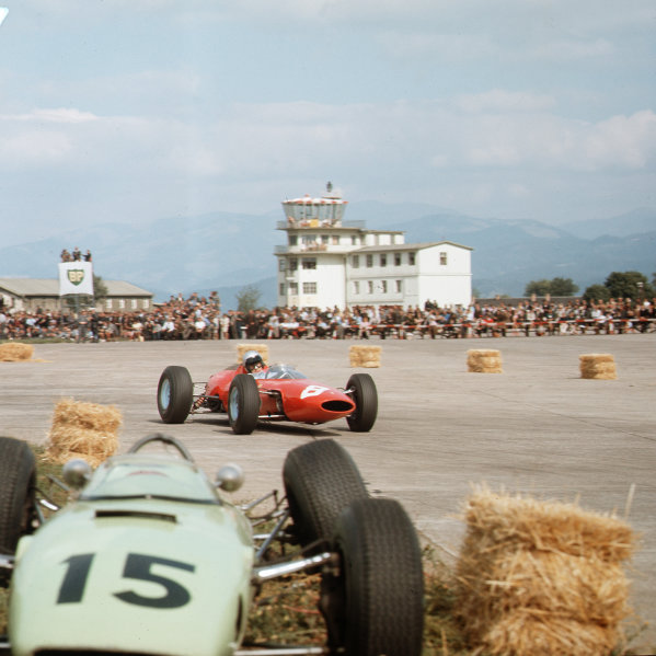 Zeltweg, Austria.21-23 August 1964.Lorenzo Bandini (Ferrari 156) passes the crashed BRP 1-BRM of Trevor Taylor. Bandini finished in 1st position for his only Grand Prix win.Ref-3/1387.World Copyright - LAT Photographic