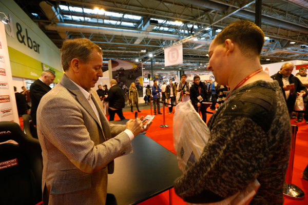 Autosport International Show NEC, Birmingham.  Sunday 12 January 2014. Martin Brundle signs an autograph for a fan. World Copyright:Alastair Staley/LAT Photographic ref: Digital Image _R6T5796