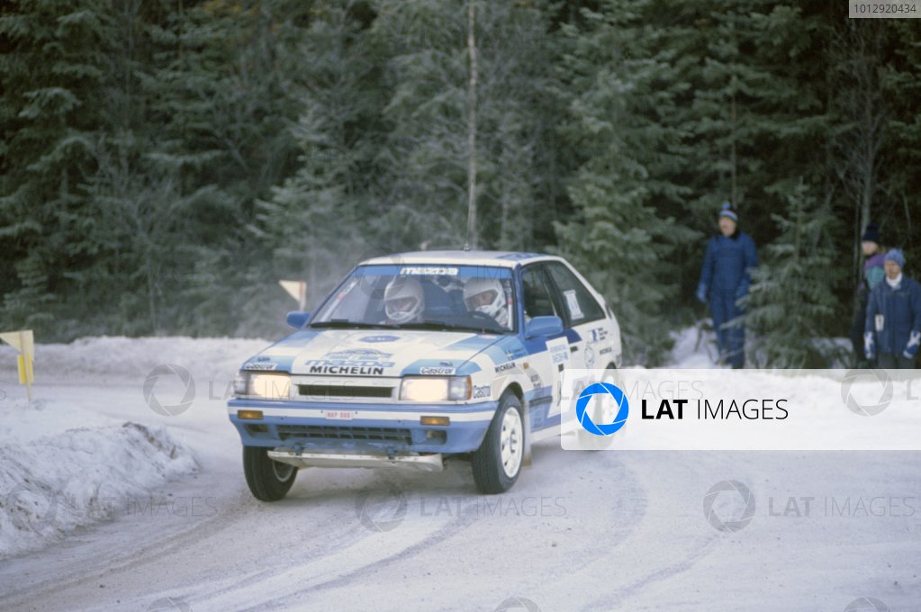 1989 World Rally Championship.Swedish Rally, Sweden. 6-8 January 1989.Ingvar Carlsson/Per Carlsson (Mazda 323 4WD), 1st position.World Copyright: LAT PhotographicRef: 35mm transparency 89RALLY01