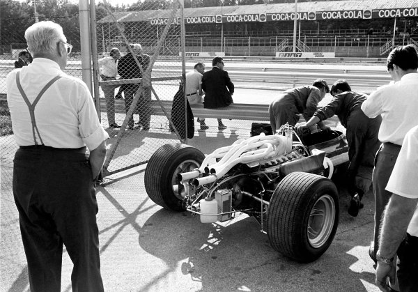 1967 Italian Grand Prix. Monza, Italy. 10 September 1967. Enzo Ferrari watches new car pushed out into the pit lane. Ref: Used Pic Motor September 13th 1967. World Copyright: LAT Photographic.