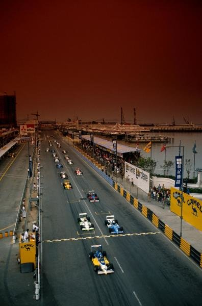 Under a red sky, Michael Schumacher (GER) leads the field from the start.  He won the first of two heats.