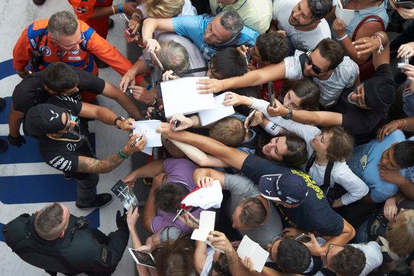 Autodromo Nazionale di Monza, Monza, Italy. Thursday 3 September 2015. Lewis Hamilton, Mercedes AMG, signs autographs for fans. World Copyright: Steve Etherington/LAT Photographic ref: Digital Image SNE23436
