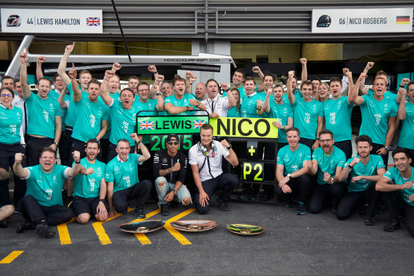 Spa-Francorchamps, Spa, Belgium. Sunday 23 August 2015. Lewis Hamilton, Mercedes AMG celebrates with Paddy Lowe, Executive Director (Technical), Mercedes AMG and the rest of the team after the race. World Copyright: Steve Etherington/LAT Photographic ref: Digital Image SNE16799