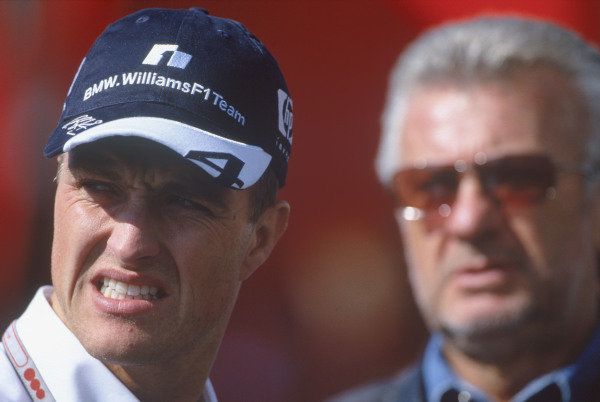 2004 European Grand Prix. Nurburging, Germany. 28th - 30th May 2004. Ralf Schumacher, BMW Williams FW26 with manager Willi Weber.World Copyright:LAT PhotographicRef: 35mm Image A05