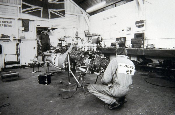 Mechanics working on the Matra MS80 of Jackie Stewart (GBR). The Tyrrell / Matra workshop was a woodshed, formerly belonging to the Tyrrell Brothers business. Formula One Features, Matra Factory, Ockham, Kent, England, 1969.
