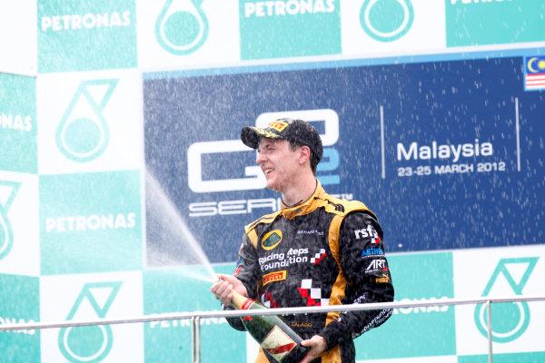 Sepang, Kuala Lumpur, Malaysia. 25th March 2012. Sunday Race.James Calado (GBR, Lotus GP) celebrates his victory on the podium. World Copyright: Alastair Staley/GP2 Series Media Service.Ref: Digital Image AS5D7698.jpg