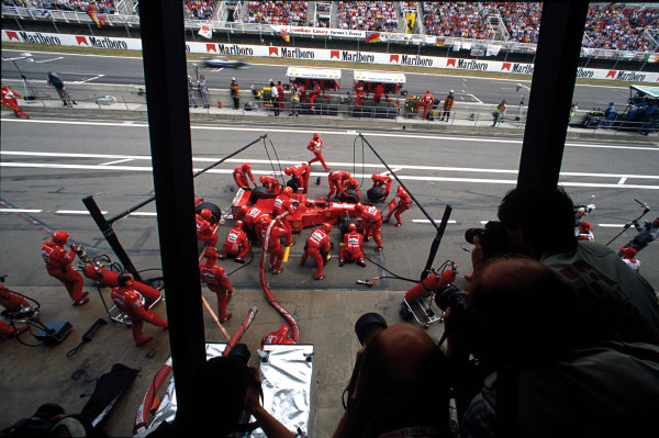 Barcelona, Spain. 23-25 May 1997. Michael Schumacher (Ferrari F310B) 4th position, takes a pitstop, action.  World Copyright: LAT Photographic. Ref:  97 ESP 05.