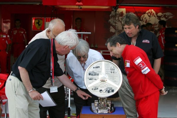 Tom Wheatcroft (GBR) Donington Park owner, Bernie Ecclestone (GBR) F1 Supremo, Jean Todt (FRA) Ferrari General Manager and Kevin Wheatcroft (GBR) of Donington Park look at The Tom Wheatcroft Trophy.Formula One World Championship, Rd11, British Grand Prix, Race Day, Silverstone, England, 10 July 2005.DIGITAL IMAGE