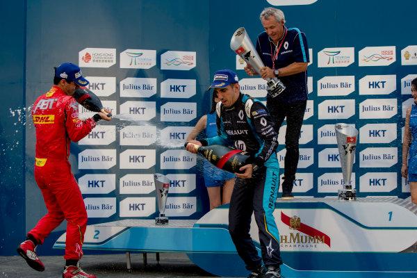 2016/2017 FIA Formula E Championship. Hong Kong ePrix, Hong Kong, China. Sunday 9 October 2016. Lucas Di Grassi (BRA), ABT Schaeffler Audi Sport, Spark-Abt Sportsline, ABT Schaeffler FE02, Sebastien Buemi (SUI), Renault e.Dams, Spark-Renault, Renault Z.E 16 and Nick Heidfeld (GER), Mahindra Racing, Spark-Mahindra, Mahindra M3ELECTRO on the podium. Photo: Zak Mauger/LAT/Formula E ref: Digital Image _X0W2975