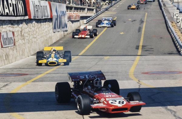 Chris Amon, March 701 Ford leads Jack Brabham, Brabham BT33 Ford and Jacky Ickx, Ferrari 312B.