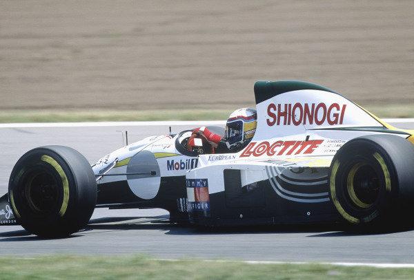 1994 Spanish Grand Prix.Catalunya, Barcelona, Spain. 27-29 May 1994.Alessandro Zanardi (Lotus 107C Mugen Honda) 9th position.Ref-94 ESP 32.World Copyright - LAT Photographic