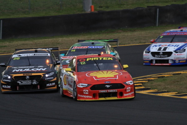 Fabian Coulthard, DJR Team Penske Ford leads Scott Pye, Charlie Schwerkolt Racing Holden
