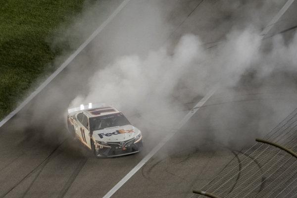 #11: Denny Hamlin, Joe Gibbs Racing, FedEx Office Toyota Camry celebrates his victory