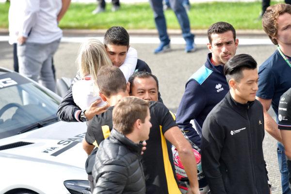 Esteban Ocon, Mercedes AMG F1, hugs Alexa Quintin, Head of Media and Communications of FIA F2 and F3