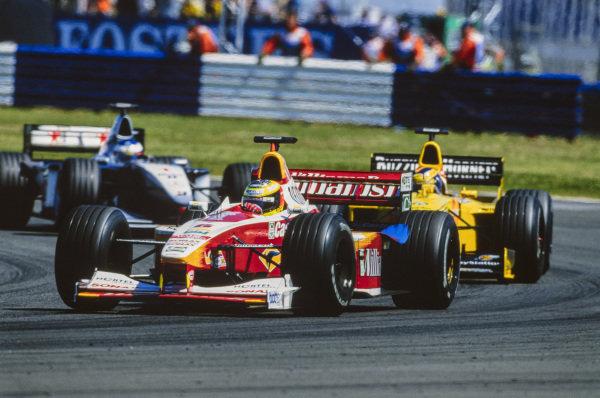 Ralf Schumacher, Williams FW21 Supertec, leads Heinz-Harald Frentzen, Jordan 199 Mugen-Honda, and Mika Häkkinen, McLaren MP4-14 Mercedes.