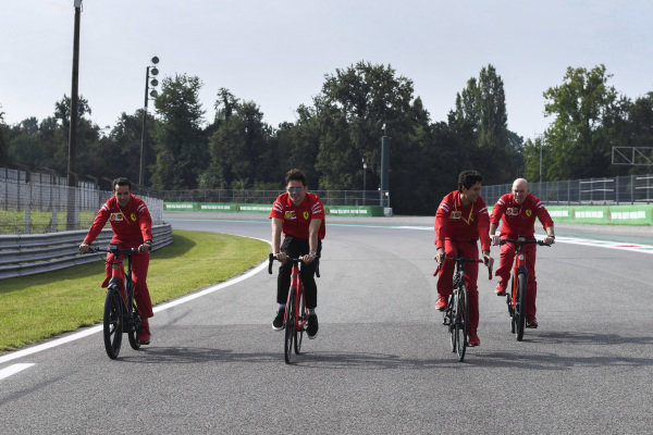 Charles Leclerc, Ferrari walks the track on a bike
