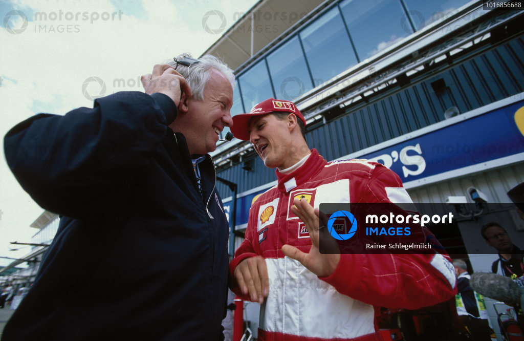 Michael Schumacher, Ferrari with Charlie Whiting, FIA Race Director.