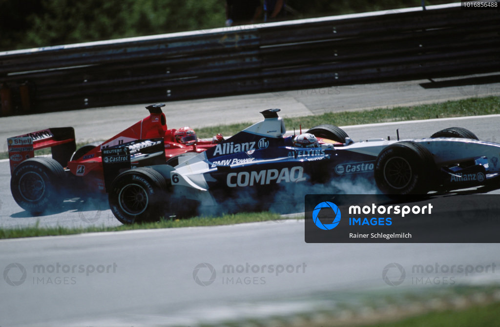 Juan Pablo Montoya, Williams FW23 BMW, locks up as he battles with Michael Schumacher, Ferrari F2001.