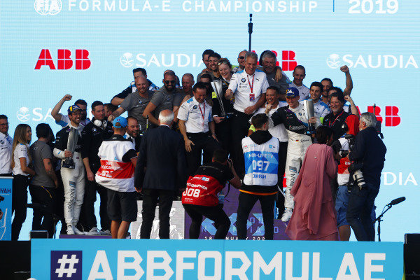 The BMW I Andretti Motorsports team celebrate on the podium