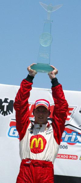 Sebastien Bourdais (FRA) Newman Haas Racing celebrates his win on the podium. Champ Car World Series, Rd3, Tecate Grand Prix, Fundidora Park, Monterrey, Mexico, 19-21 May 2006. DIGITAL IMAGE