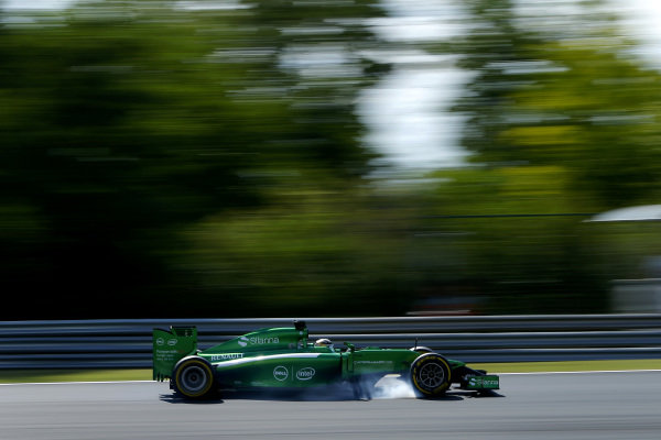 Kamui Kobayashi (JPN) Caterham CT05 locks up his brakes. Formula One World Championship, Rd11, Hungarian Grand Prix, Practice, Hungaroring, Hungary. Friday 25 July 2014.  BEST IMAGE